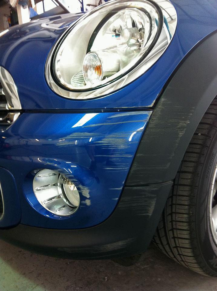 Badly scratched car bumper