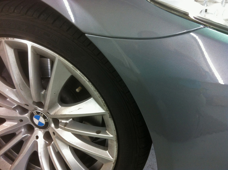 Scratched BMW bumper after Paintmedic repair