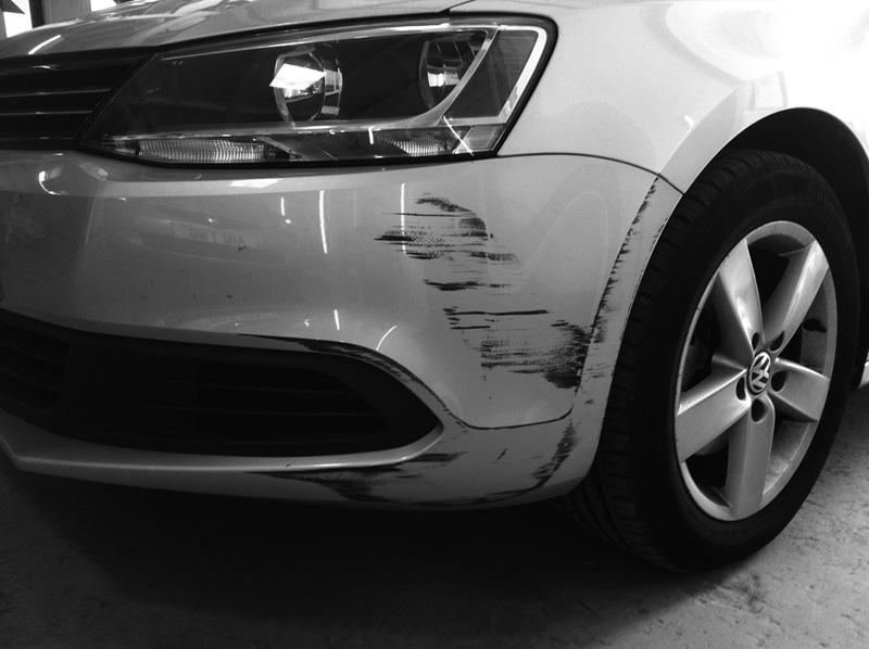Bad bumper scuff before repair