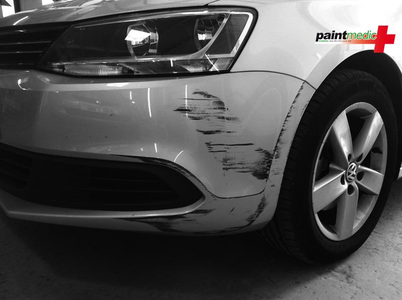 Bumper scuff before repair