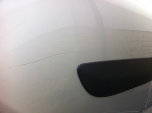 White car scratch before Paintmedic repair
