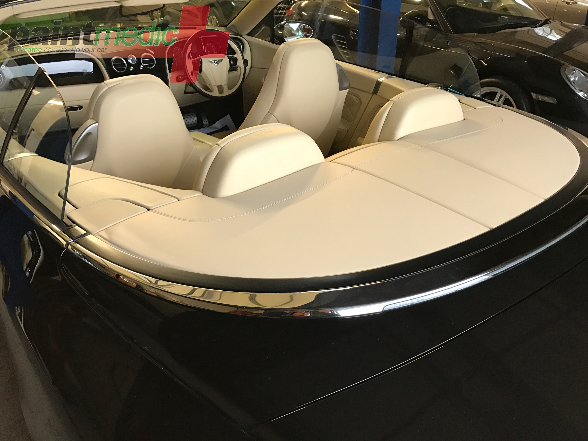Bentley Continental rear shelf water damage after repair by Paintmedic